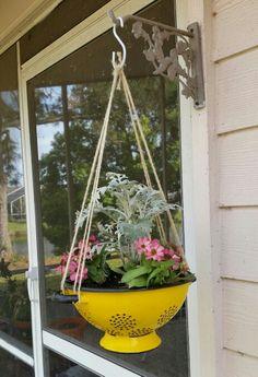 Repurpose an old colander into a hanging basket.
