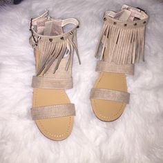 Beige Fringe Sandals in Size 7.5 Brand new size 7.5 beige fringe sandals with full zipper in back for secure closure. Silver rivets are designed around top adjustable ankle strap. Shoes Sandals