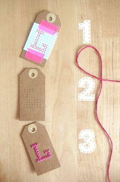About the nice things: Etiquetas a punto de cruz