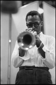 Miles Davis , trumpet player- my favorite. Played endlessly while I was preggo with you.