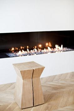 Eclectic minimalistic apartment in Paris. Design by Frederic Berthier, photo by Benoit Linero Wood Furniture, Furniture Design, Christian Liaigre, Wood Stool, Fireplace Design, Simple Fireplace, Modern Fireplace, Apartment Interior Design, Interior Ideas
