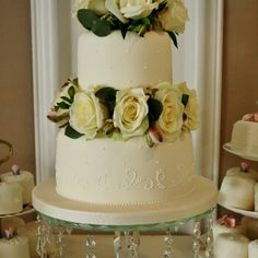 Wedding Cakes | Sylvia's Kitchen Two tier wedding cake with sugar piped work and beading, finished with fresh Avalanche Roses, Astromaria and Eucalyptus