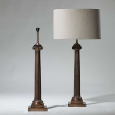 Pair of tall antique copper column lamps