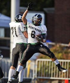 Kentwood's Chansen Kalua-Fuimaono celebrates a touchdown with offensive lineman Travis Kersey (71). See more of Seattle Times photographer Dean Rutz's photos from the game.