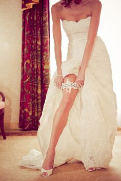 So I am usually not a fan of garter pictures, but some how this escapes being slutty and is just fabulous. If my leg looks like that on my wedding day I might recreate it. Maybe.