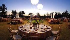 An outside wedding reception produced by Weddings Unique