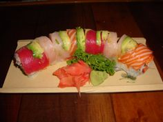 Rainbow Roll-This sushi favorite is made from a variety of fresh raw fish and avocado.
