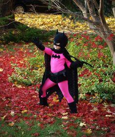 A Pink And Black Batgirl Costume