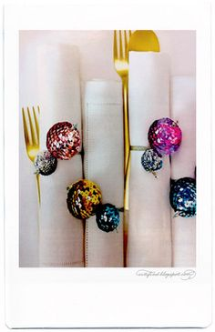 The fun & festive napkin holders were created from strings of sequins & paillettes wrapped around styrofoam spheres.