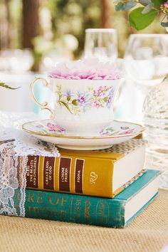 loving these book centerpieces http://www.weddingchicks.com/2013/09/30/vintage-vineyard-wedding/