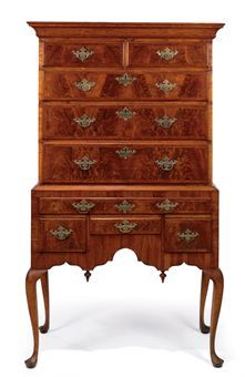 A QUEEN ANNE FIGURED WALNUT AND MAPLE FLAT-TOP HIGH CHEST-OF-DRAWERS. New England, 1740-60