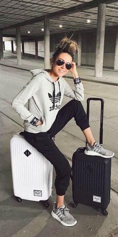 Christine Andrew + simple but stylish + grey Adidas hoodie + black joggers + grey sneakers + sporty chic style + perfect for travelling long journeys Sweater: Adidas.