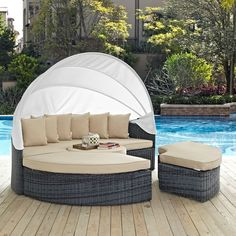 Summon Canopy Outdoor Patio Sunbrella® Daybed in Antique Canvas Beige - Lifestyle