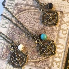 Compass charm necklaces by RedLanternDesigns on Etsy
