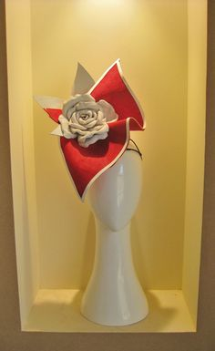Jill and Jack Millinery. Sculptured rose leaves in red. Hand dyed buntal linen straw that has been backed and sculptured into this beautiful leaf like shape. set with a hand made white leather rose and leaves