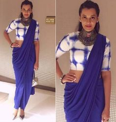 Mugdha Goes For Drapes And Dyes... Colored in blue, Mugdha Godse attended society awards in a beautiful indo-western Saree by Mint Blush designs. She wore a blue draped saree with a tie-dye blouse and completed this look a heavy tribal choker with Beautiful Boho.. Shop at https://www.estrolo.com/whatstrending/mugdha-goes-drapes-dyes/
