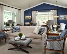 Love the sandy couch with the navy walls. Could use Christina's chairs in the office with the recovered couch....
