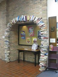 Book arch donated in honor of Dillon Spencer. Book Arch, School Library Displays, Arch Doorway, Future Library, Elementary Library, Warm Blankets, Book Themes, Media Center, Fantasy Literature