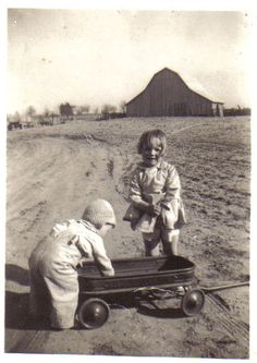 Vintage photo of farm kids at play.