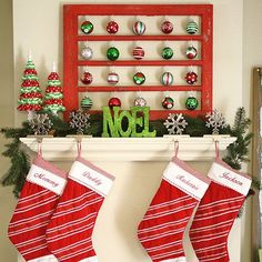 Traditional glass ornament balls take the stage in this Christmas mantel design giving it a fun and festive look.