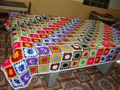 Crochet granny square blanket, rows of color.