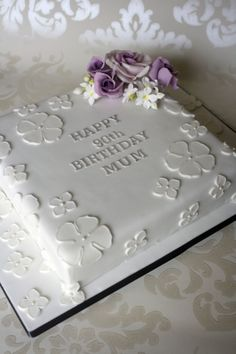 90th birthday cake, with lilac roses and applique icing detail.  By www.plumbandrabbitts.co.uk
