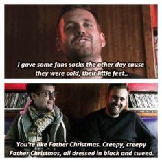 Creepy creepy Father Christmas in balck and tweed