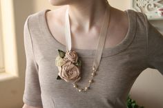 Fabric flower necklace. Ashley A unique vintage inspired design featuring hand made silk flowers, pearls, and satin ribbon.. $30.00, via Etsy.