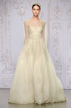 This Monique Lhuillier golden color long sleeves wedding dress is just stunning!