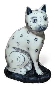 AN ENGLISH DELFTWARE BLUE AND WHITE MODEL OF A CAT CIRCA 1760