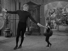 Wednesday ( Lisa Loring) teaching Lurch (Ted Cassidy) how to dance.