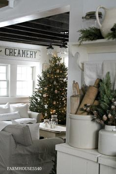 Here is our farmhouse all decorated for Christmas...come on in!!!                  I have greens tucked just about everywhere I can get the...