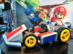 Nintendo teamed up with West Coast Customs to create two fully functional front-wheel drivereal-life Mario Karts for display at the Los Angeles Auto Show. This is Mario's classic kart here but there's a Luigi bee-mobile or whatever after the. Mario Kart, West Coast Customs, Cardboard Car, Weird Cars, Go Kart, Super Mario, Nintendo, Playroom, Custom Made