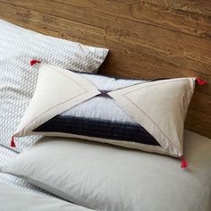 Made with traditional Thai textiles purchased by our team on their travels, these pillows are manufactured in New Mexico by Southwest Creations using modern applique patterns and stitch details.