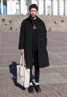 """""""The coat, sweater and trousers are from Uff, the socks from American Apparel and vintage Dr Martens from New York.The contrast of white and black has inspired me lately. Skinny jeans forever – they stay, while the rest can change."""""""
