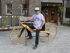 A member of staff on a wooden bike created at the Mill.