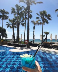 Take the pleasure in enjoying a fresh poolside BLUE cocktail in Amàre Pool. #AmareMarbella #summervibes #blue #marbellahotel #marbella #mediterranean #amarepool #palmtrees #palm