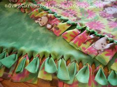 """Sewing Blankets Adventures of a DIY Mom: No Sew Fleece Blanket For baby blanket: yard, kids: teens/adults: 2 - How to make a no-sew fleece blanket. This is not your typical """"tie the ends"""" blanket. Create a classy fleece blanket with this tutorial Fleece Blanket Edging, Knot Blanket, Fleece Tie Blankets, No Sew Blankets, Kids Blankets, Flannel Baby Blankets, Diy Craft Projects, Fleece Projects, Kids Crafts"""
