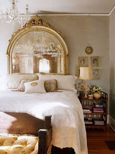 Lovely and enchanting feminine bedroom with a vintage mirror used as a headboard serving as the focal point of the room