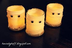 Spooky Mummy Candles  - These homemade Halloween decorations are not only easy to make but super cheap as well
