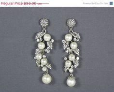 ON SALE Ivory Pearl Bridal Earrings, Bridal Pearl Swarovski Crystal Drop Earrings, Statement Earrings, Vintage Style Drop Earrings, Bridal. $32.40, via Etsy.