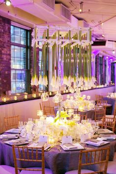 Soft twilight color lighting with white centerpieces  Creative modern reception design by Tantawan Bloom