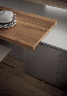 A colour contrast is created by the Ebony Lapitec® worktops in Vesuvio fi nish and by the Vintage Oak breakfast bench.