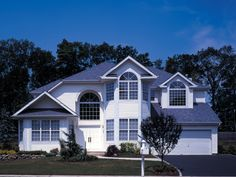 Dramatic Two-Story With Half-Round Windows | Plan 016D-0046
