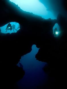 Cave diving the Cathedral at Pescador Island in the Philippines.  By Henry Jager
