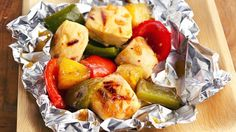 Bell peppers and other sweet-and-sour ingredients add incredible flavor to chicken when steamed together on the grill inside no-fuss foil pockets.