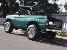 deep green vintage ford bronco top roof off