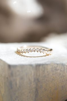 An arched version of our Petite Domino Marquise Band. Petite slanted marquise diamonds in an arch provide a domino effect of sparkle. This ring makes a perfect wedding band, addition to a ring stack or stand alone piece.
