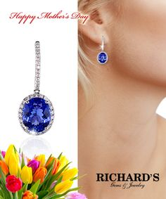 Oval tanzanite and diamond dangle earrings in 18k white gold