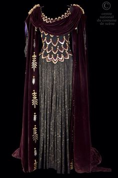 It's a lot... tone down color, apply '20s silhouette, use the cape as the shape of the neckline and for the shoulder details. Should read as greek and less intense. (try lighter colors)